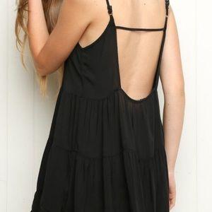 Brandy Melive black dress